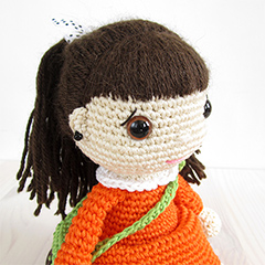 Girl in a dress with a messenger bag amigurumi by Kristi Tullus