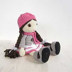 Girl in a dress, jacket, boots and hat amigurumi pattern by Kristi Tullus
